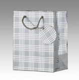 Silver gift bag with tag Stock Photo