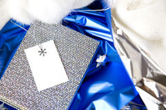 Silver gift on blue Royalty Free Stock Photography