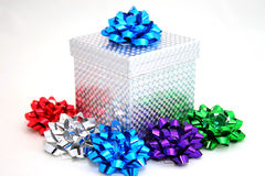 Silver gift with bows Royalty Free Stock Images