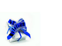 Silver gift box. With blue ribbon isolated on white royalty free stock photos
