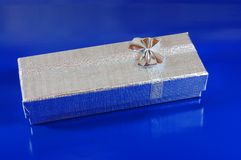 Silver Gift box. On blue background Stock Image