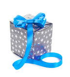Silver gift box with a blue bow. Royalty Free Stock Image