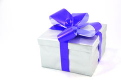 Silver gift box with blue bow isolated on white. Background Royalty Free Stock Photo