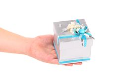 Silver gift box with blue ribbon. On a white background Stock Photography