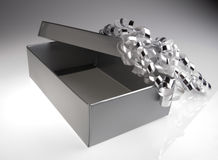 Silver gift box with bow. A silver gift box with decorative bow Stock Image