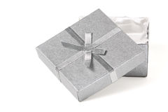 Silver gift box and bow. Slightly opened silver gift box with silver bow; white background with enough room for a message stock image