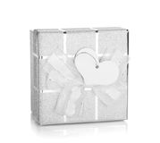 Silver gift box with bow and heart label Stock Photos