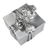 Silver gift box with elegant ribbon bow on white Stock Images