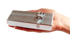 Silver Gift box in hand Stock Image
