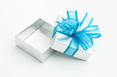 Silver gift box is opened. On white background Royalty Free Stock Photography