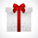 Silver gift box with red bow (ribbon). Present Stock Photography
