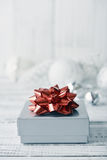 Silver gift box. With red bow on wooden background closeup Stock Photo
