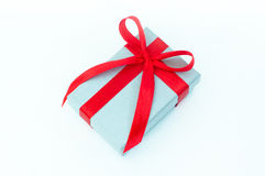 Silver gift box with red ribbon. Isolated on white Stock Images