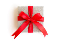 Silver gift box with red ribbon with clipping path included Royalty Free Stock Images