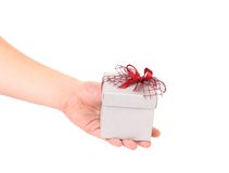 Silver gift box with red ribbon. Royalty Free Stock Images