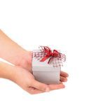 Silver gift box with red ribbon. Stock Photos