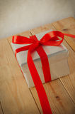 Silver Gift Box with Trailing Red  Ribbon Royalty Free Stock Photography