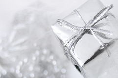 Silver gift box on white blur background Royalty Free Stock Image