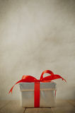 Silver Gift box on Wood Table Royalty Free Stock Photography