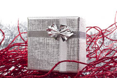 Silver gift in christmas decorations. With white background Royalty Free Stock Image