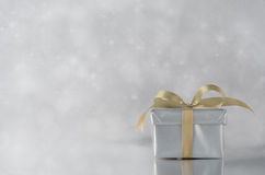 Silver Gift - Gold Ribbon Stock Photos