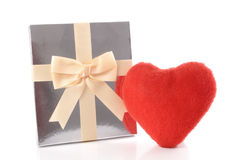 Silver gift and Heart Stock Photos
