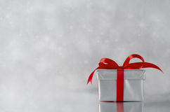 Silver Gift - Red Ribbon Royalty Free Stock Image