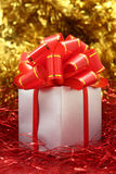 Silver gift wrapped present with red bow Royalty Free Stock Photos