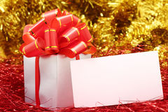 Silver gift wrapped present with red bow Stock Photography