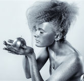 Silver girl with apple Stock Photo