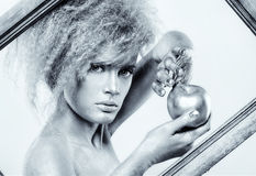 Silver girl with apple Stock Photos