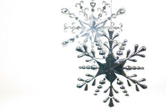 Silver and glass Christmas hanging star Stock Photo