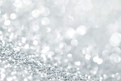 Silver glitter background. With beautiful bright bokeh lights Stock Images