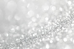 Silver glitter background. With beautiful bright bokeh lights Stock Photography