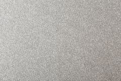 Silver glitter background, shiny paper texture. Silver glitter background, shiny wrapping paper texture stock photos