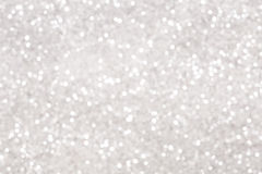 Silver glitter bokeh background. Blurred glowing circles royalty free stock photography