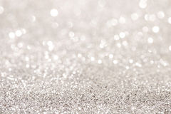 Silver glitter bokeh background. Blurred glowing circles stock photography