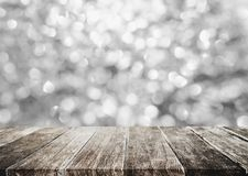 Silver glitter Bokeh light with wooden panel for background. S Royalty Free Stock Images