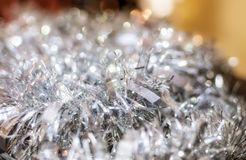 Silver glitter at Christmas. Silver Christmas decorations on an abstract bokeh lights defocused background. Christmas and New Year Holiday concept Stock Image