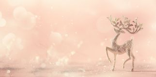 Silver glitter Christmas deer on pink background with lights bokeh, copy space. Greeting card for new year party. Festive holiday. Concept. Banner stock photography
