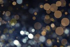 Silver glitter on dark background. Bokeh effect stock image