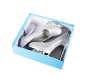 Silver glitter shoes in turquoise box Royalty Free Stock Photography