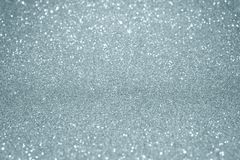 Silver glitter texture background with blur light effect and shiny sparkling particles. Glittering silver or shining snow light fo. R modern trendy festive stock photo