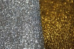 Silver glitter texture. Bokeh effect. Silver and golden glittery shimmering background with blinking details stock photos