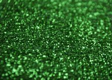 Silver glitter texture. Bokeh effect. Green glittery shimmering background with blinking details royalty free stock photo