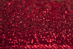 Silver glitter texture. Bokeh effect. Red glittery shimmering background with blinking details stock photography