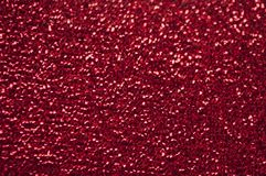 Silver glitter texture. Bokeh effect. Red glittery shimmering background with blinking details royalty free stock photography