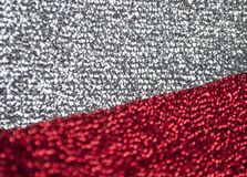 Silver glitter texture. Bokeh effect. Silver and red glittery shimmering background with blinking details royalty free stock photography