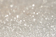 Silver glittering christmas lights. Blurred abstract holiday bac Stock Photo