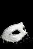 Silver glittering mask and black pearls Royalty Free Stock Image